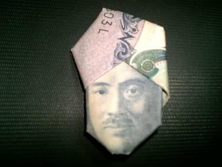 1000円札でターバン野口を・・・。